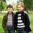 Boy with a friend in the green park — Stock Photo #6707715