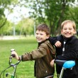 Boy on a bicycle in the green park — Stock Photo #6707781