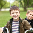 Boy on a bicycle in the green park — Stock Photo #6707802