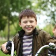 Boy on a bicycle in the green park — Stock Photo #6707838