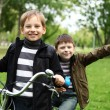 Boy on a bicycle in the green park — Stock Photo #6707896