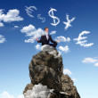 Businessman on the top of a high mountain — Stock Photo #6707991