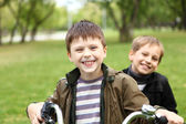 Boy on a bicycle in the green park — Stock Photo