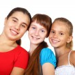 图库照片: Three teenage girls together