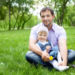 Portrait of father with daughter outdoor — Stock Photo #6741347