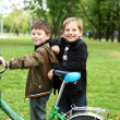 Boy on a bicycle in the green park — Stock Photo #6741398