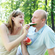 Young couple on picnic in the park — Foto de Stock