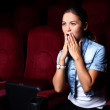 Young girl in cinema — Stock Photo #6741468