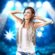 Young dancing blond woman — Stock Photo
