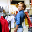 Young girl buying clothes — Stock Photo #6741664