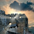 Stock Photo: Ruins of old castle at sunset