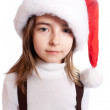 Stock Photo: Little girl with santa's hat