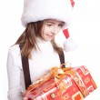Little girl with santa's hat and gift holding — Stock Photo #5781975