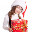Little girl with santa's hat and gift holding — Stock Photo #5781978