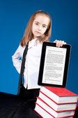Girl with ipad like gadget — Stock Photo