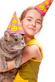 Birthday girl and cat — Stockfoto