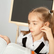 Stock Photo: School girl read interesting book.