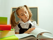 School girl reading interesting book. — Stock Photo