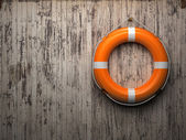 Lifebuoy attached to a wooden wall — Stock Photo