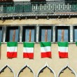 Stock Photo: Windows with italiflags,old Venice