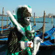 Green mask at Venice embankment during carnival 2011 — Stock Photo