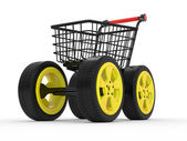 3d shopping cart with big car wheel — Stock Photo