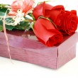 Stock Photo: Three beautiful red roses on carton