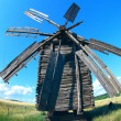 Old mill in field — Stock Photo