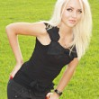 Stock Photo: Blonde in black tanktop and shorts