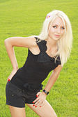Blonde in black tanktop and shorts — Stock Photo