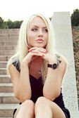 Portrait beautiful blonde on nature — Stock Photo