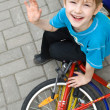 Stock Photo: Boy sits on bicycle