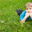 Little boy laying on the grass — Stock Photo