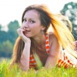 Beautiful woman laying on grass — Stock Photo #6390790