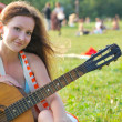Young woman with guitar — Stok fotoğraf
