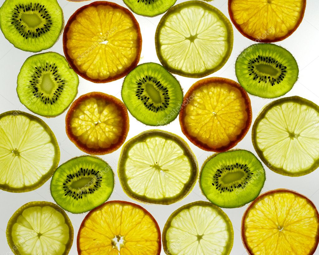 Sliced citrus fruits background ( lemon, orange, kiwi) — Stock Photo #5478226