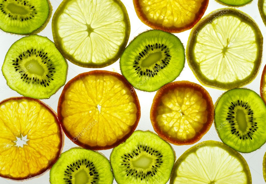 Sliced citrus fruits background ( lemon, orange, kiwi) — Stock Photo #5478261
