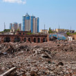 New buildings on background of old ruins — Stock Photo #5789170