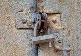 Old padlock on a metal door — Stock Photo