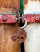 Rusty padlock on an old metal door — Stock Photo
