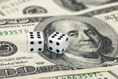 Gaming dice and money — Stock Photo