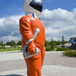 Cosmonaut in an orange suit — Stock Photo