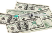 Addiction concept - narcotic, money and syringe against white — Stock Photo