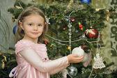 Three year old girl near the Christmas tree. — Stock Photo