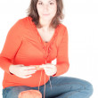 Portrait of pretty pregnant woman knitting — Stock Photo