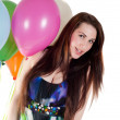 Beautiful woman with multicolored air balloons — Stock Photo