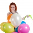 Beautiful woman with multicolored air balloons — Stock Photo #6053740