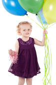 Little cute girl with multicolored air balloons — Stockfoto