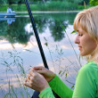 Stock Photo: Fisherwoman on the river