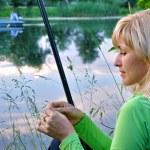 Fisherwoman on the river — Stock Photo